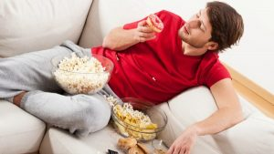 Our caloric intake is increased through between-meal snacking while watching TV [Image: Katarzyna Bialasiewicz]